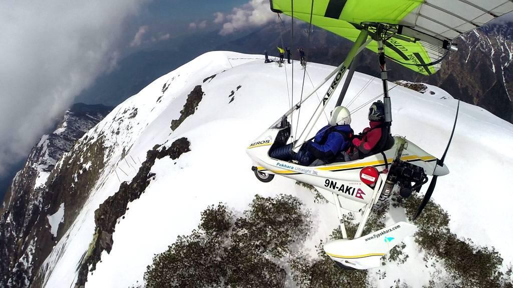 Aeros 9N-AKI over the snow mountain